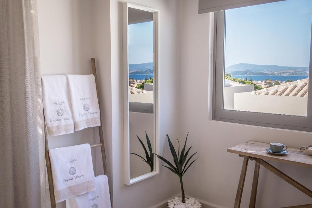 crystal waters suites nikiana lefkada 2 bed rozoli room partial sea view 5